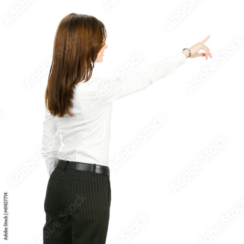 Young business woman pointing at something in her back, isolated
