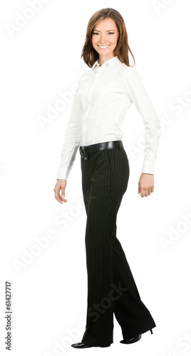 Full body portrait of walking businesswoman, isolated