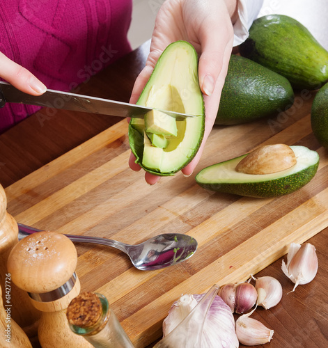female hands cooking with avocado