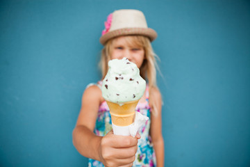 Ice cream cone held by young girl