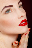 Portrait of young pretty model with bright makeup and manicure.