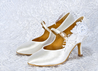 White shoes of bride at wedding shiny fabric