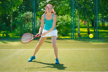 Portrait of young beautiful woman playing tennis