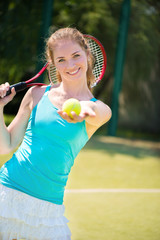 Portrait of  pretty young tennis player