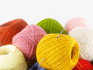 Close up of colorful yarn on white background