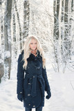 Young blonde woman in winter