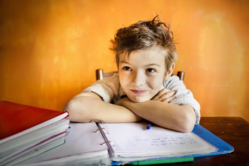 A young boy concentrating on homework.