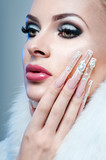Nail art. Beautiful Woman With perfect  Nails and Luxury Makeup.
