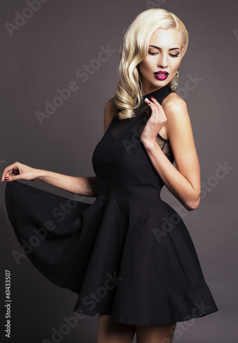 sexy blond woman in elegant black dress