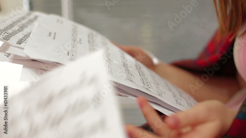 Woman looking through note sheets