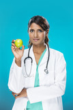 Indian doctor holding an apple.
