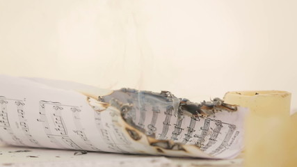Note sheet burning. Close-up