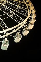 Ferris wheel illuminated at night.