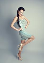 Happy smiling brunette model with braid wearing luxury dress