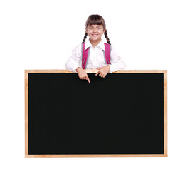 Portrait of a schoolgirl pointing to the school blackboard
