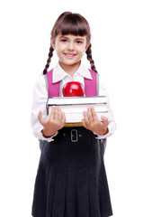 schoolgirl in uniform holding books and apple