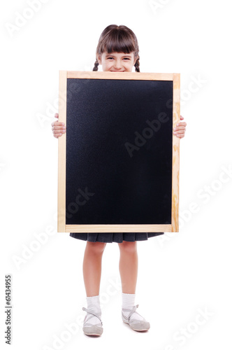 F schoolgirl holding the school board