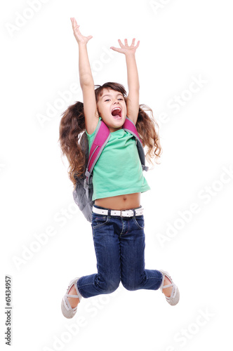 Happy schoolgirl jumping high on white background