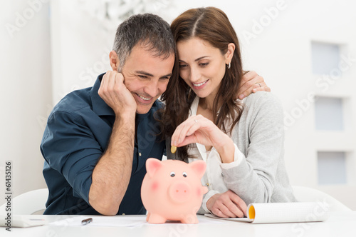 Couple Saving Money - 61435126