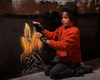 Flames of hope - homeless boy warming