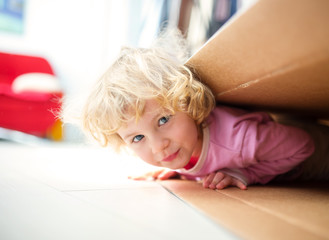 Little girl inside a paper box