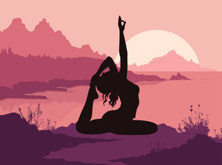 Silhouette of woman doing yoga in mountins