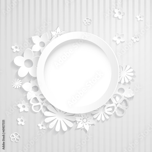 Paper flowers with ring on white