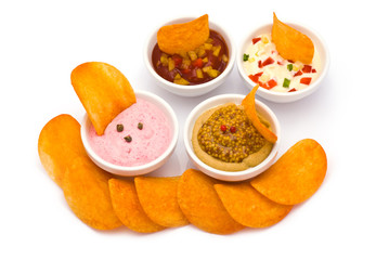 Potato Chips with various Dip Sauces isolated on white