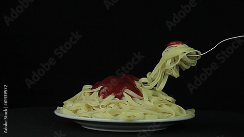 Noodles rotates on a black background