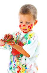 Smiling boy paints paints