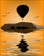 Reflection of the balloon in the sea at sunset