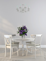Shabby chairs and the dining table with a bouquet of lilacs