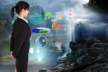 Composite image of businesswoman standing