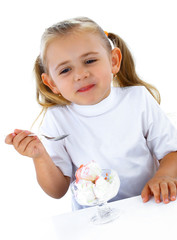 Little smiling girl eating ice cream