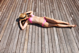 Woman sunbathing lying at deck
