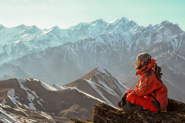 Man meditating on the top of the mountain