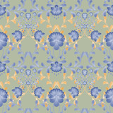 Floral seamless pattern with blue flowers texture gzhel on green