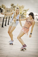 summer fun healthy girls with skateboards.