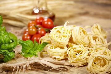 Italian food background, with vine tomatoes, basil, spaghetti