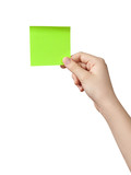 female teen hand holding green sticky note