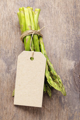 bunch of green asparagus tied with twine
