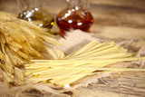 Bundle of uncooked dried Italian spaghetti  on old wood table