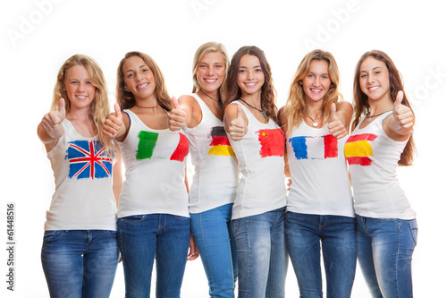 Fototapeta international teens with flags on t shirts