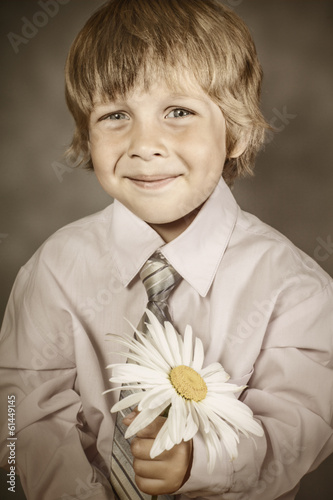 boy wearing classic suit with flowers