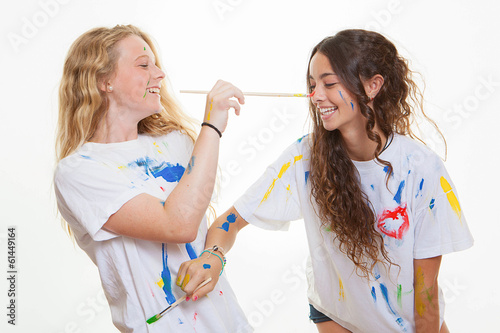 girls playing painting each other