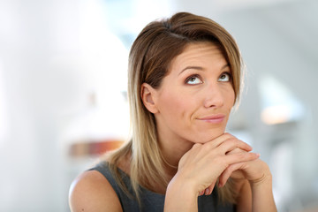 Portrait of businesswoman with thoughtful look
