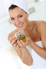 Portrait of beautiful woman drinking herbal tea