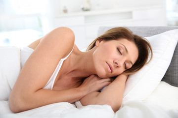 Closeup of woman asleep in bed