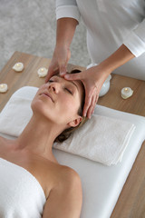 Woman having a face massage in beauty institute