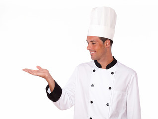 Latin chef holding up his right hand